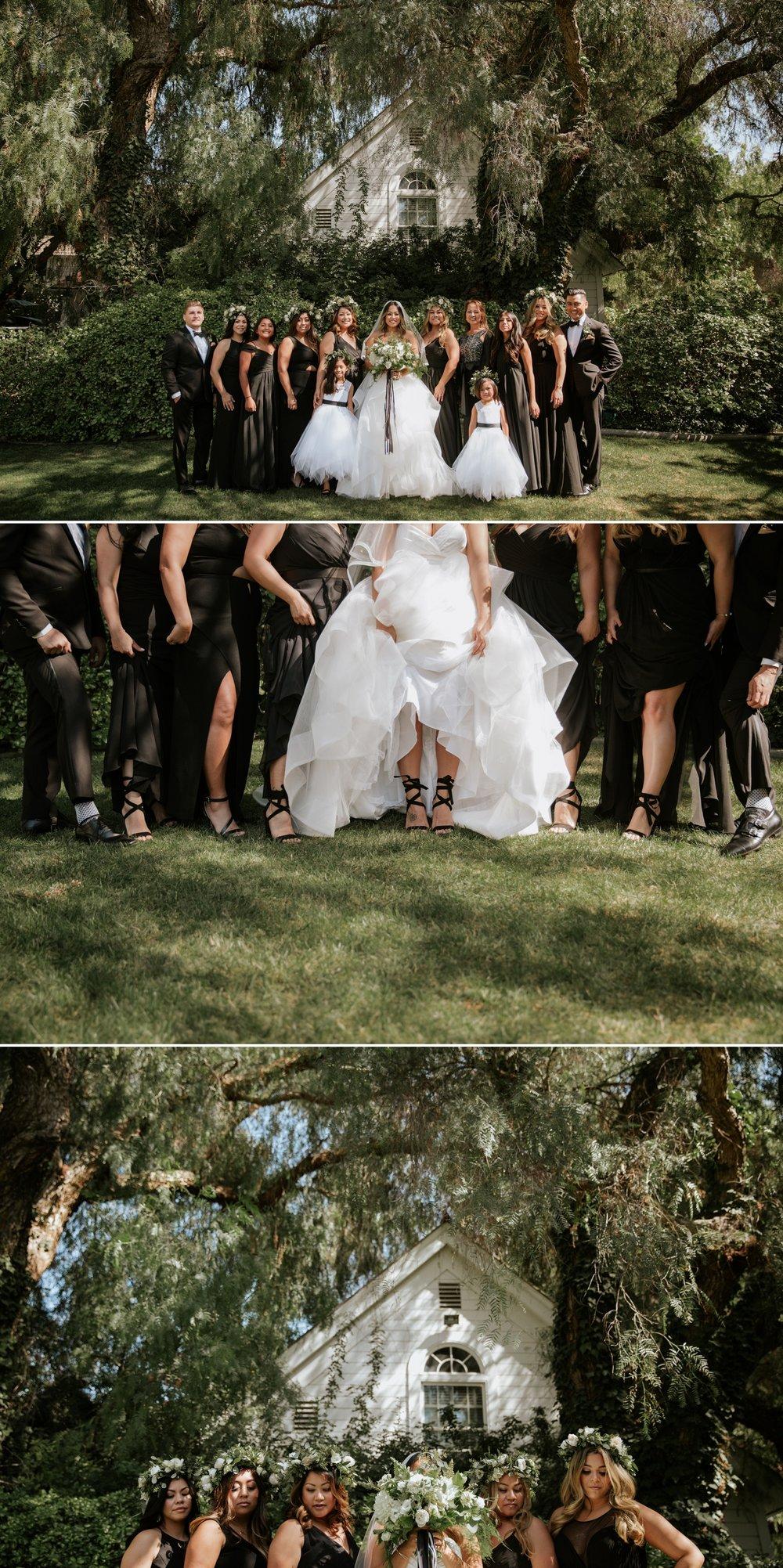 All black bridesmaid's dresses at garden wedding venue in San Diego