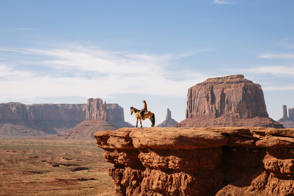 Self portrait in Monument Valley on horse by San Diego photographer Paige Nelson