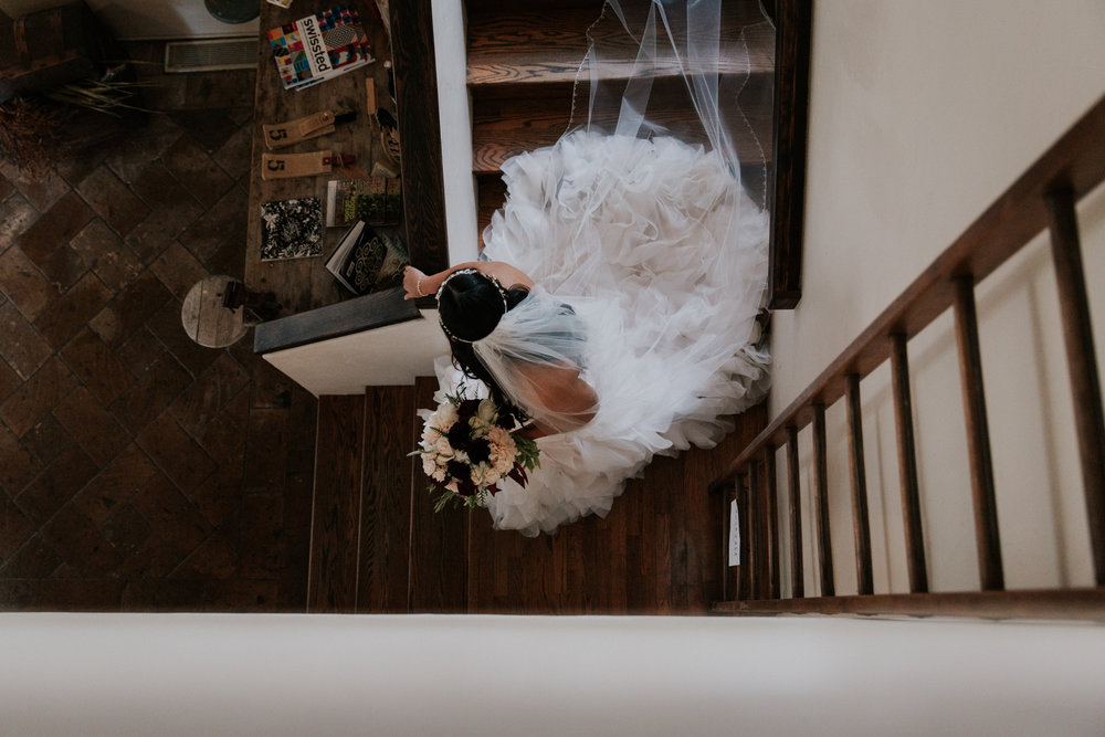 Bride coming down stairs at Folktale Winery in Carmel by San Diego photographer Paige Nelson