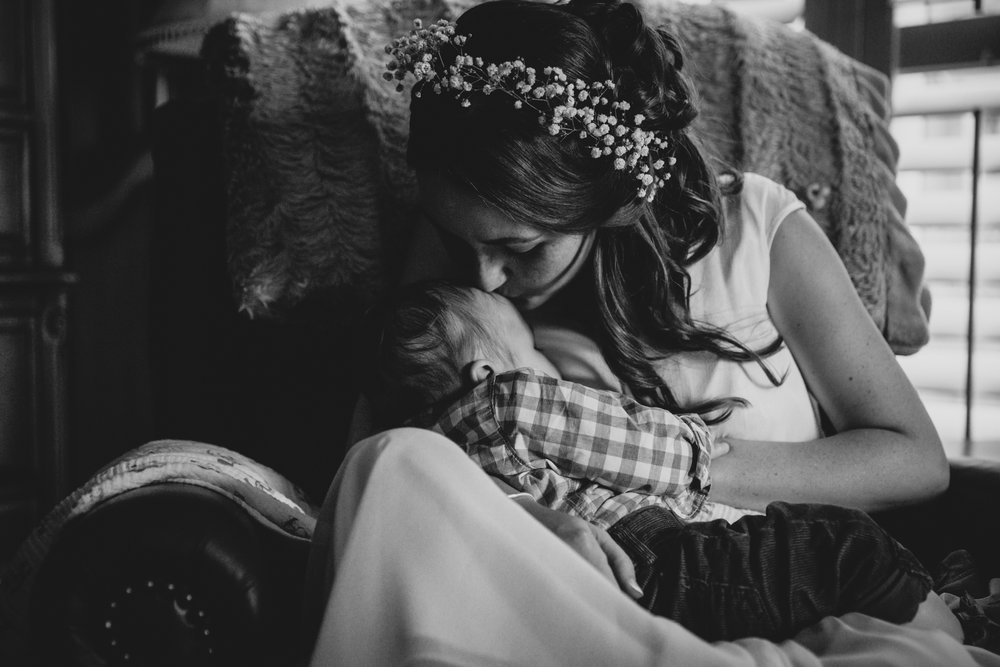 Bride breastfeeding baby at intimate wedding by San Diego photographer Paige Nelson