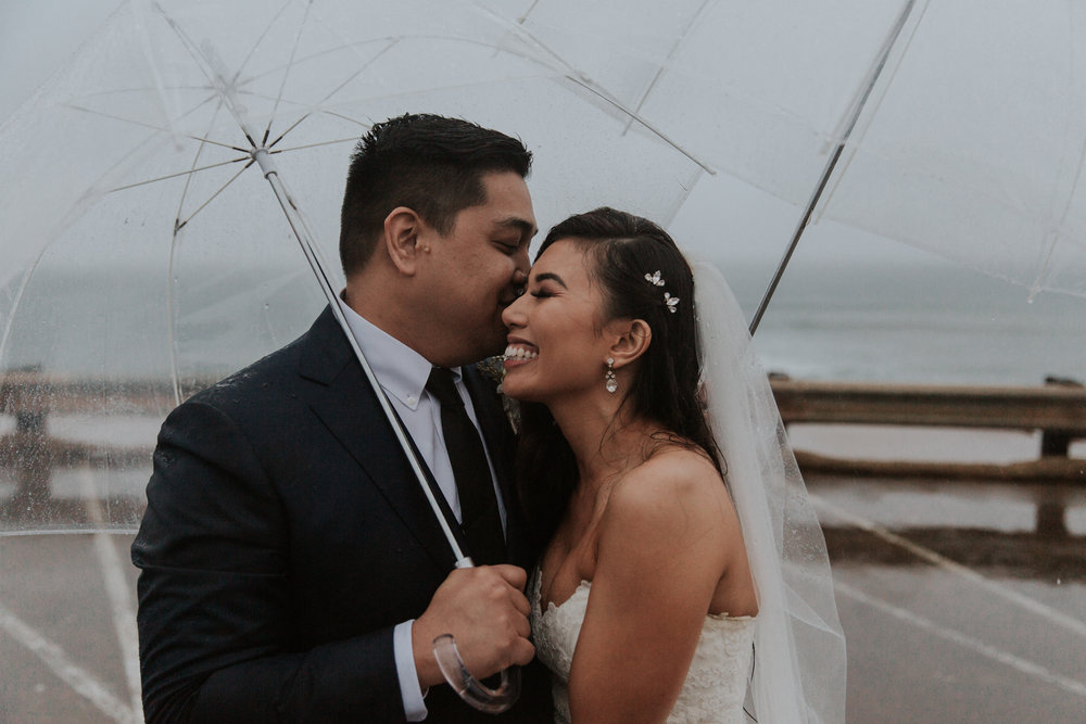 Rainy day wedding portraits by San Diego photographer Paige Nelson
