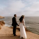 Bohemian Sunset Cliffs wedding with Dreamers and Lovers Bride